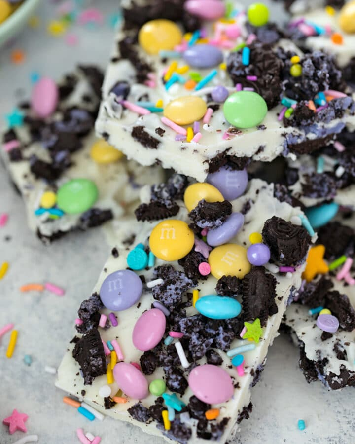 Overhead view of Easter Oreo Bark with white chocolate, Oreo cookies, M&Ms, and sprinkles broken into pieces