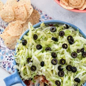 Easy Taco Dip -- There's nothing fancy about this taco dip, but it will take you five minutes to put together and will likely be the hit of the party. With just five ingredients, all of your friends will be asking for the recipe | wearenotmartha.com