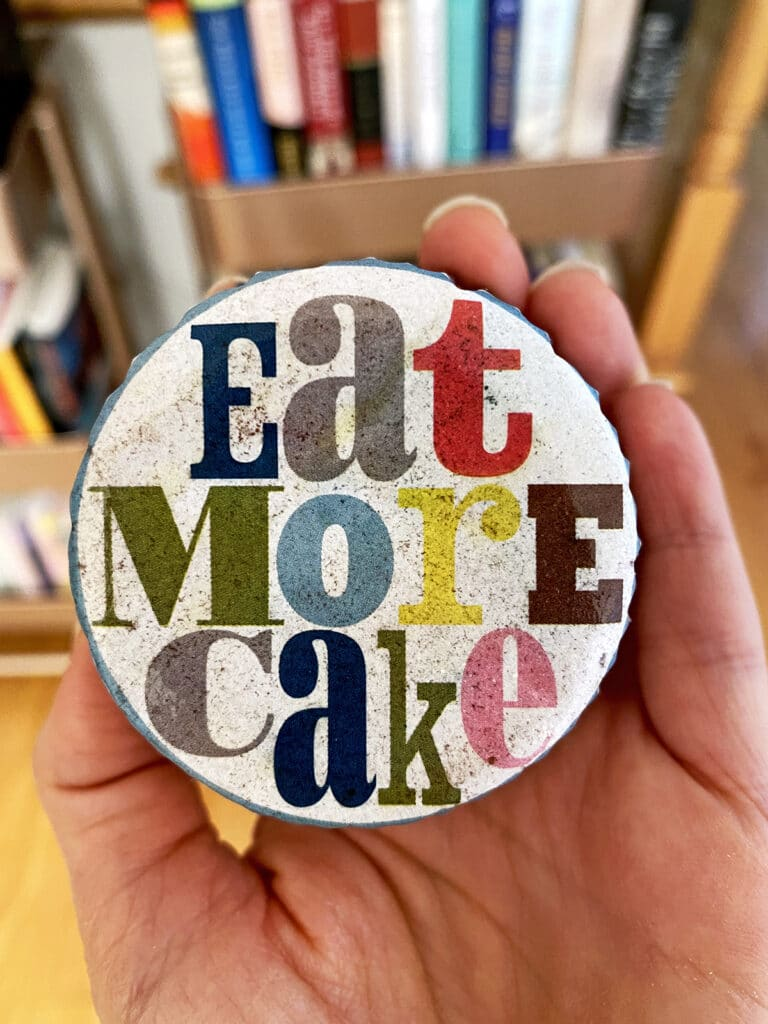 "Cupcake paper that says ""eat more cake"""