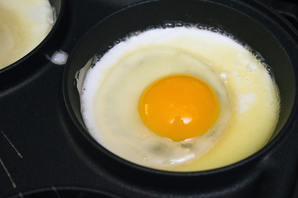 View of sunny-side up egg cooking in pan