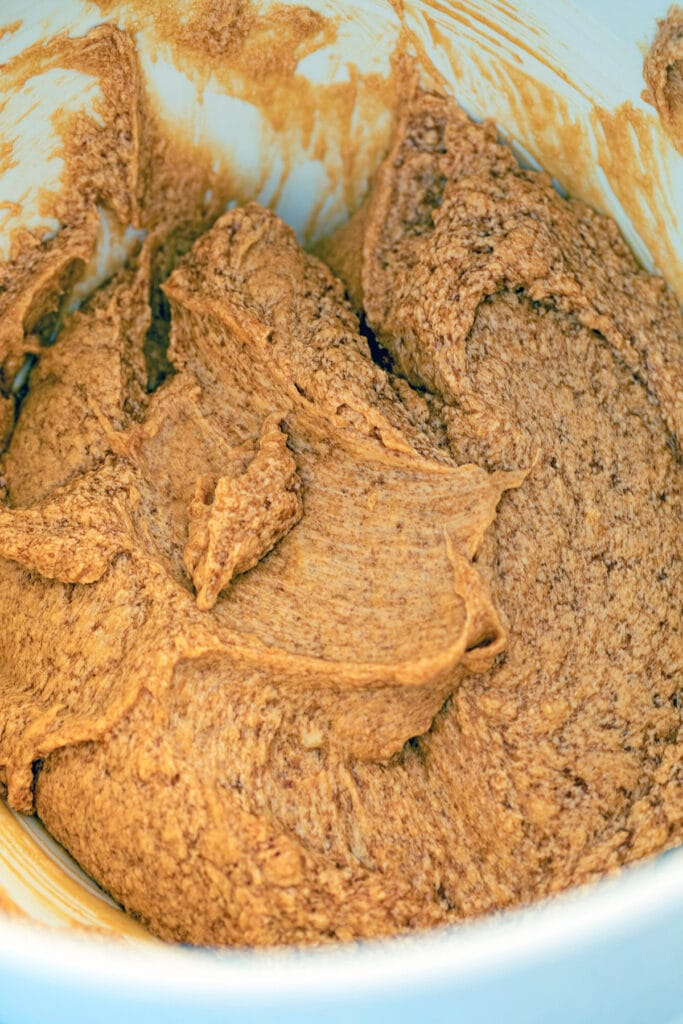 Molasses-colored cookie batter in mixing bowl
