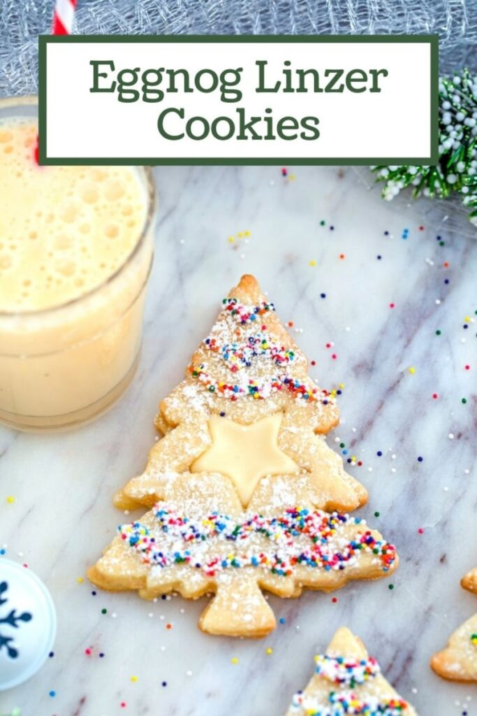 These Eggnog Linzer Cookies involve eggnog icing sandwiched between two Christmas tree cookies and are the ultimate holiday cookie | wearenotmartha.com #christmascookies #eggnogcookies #eggnogrecipe #holidayrecipes