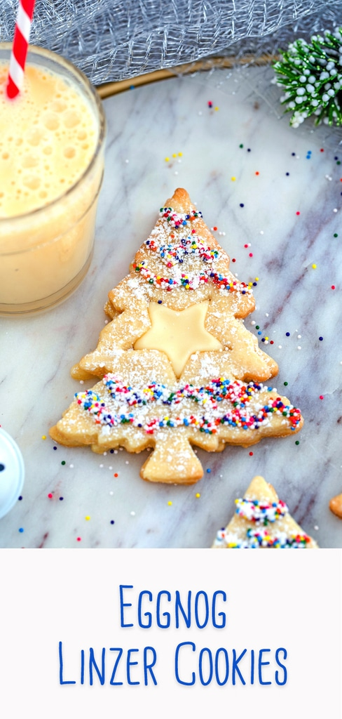 Eggnog Linzer Cookies -- These Eggnog Linzer Cookies will be the hit of the holiday cookie platter! The cookies are made with a splash of eggnog and a delicious eggnog icing is sandwiched between the two cookies for a delightful holiday treat | wearenotmartha.com #eggnog #cookies #linzercookies #christmas #holidays