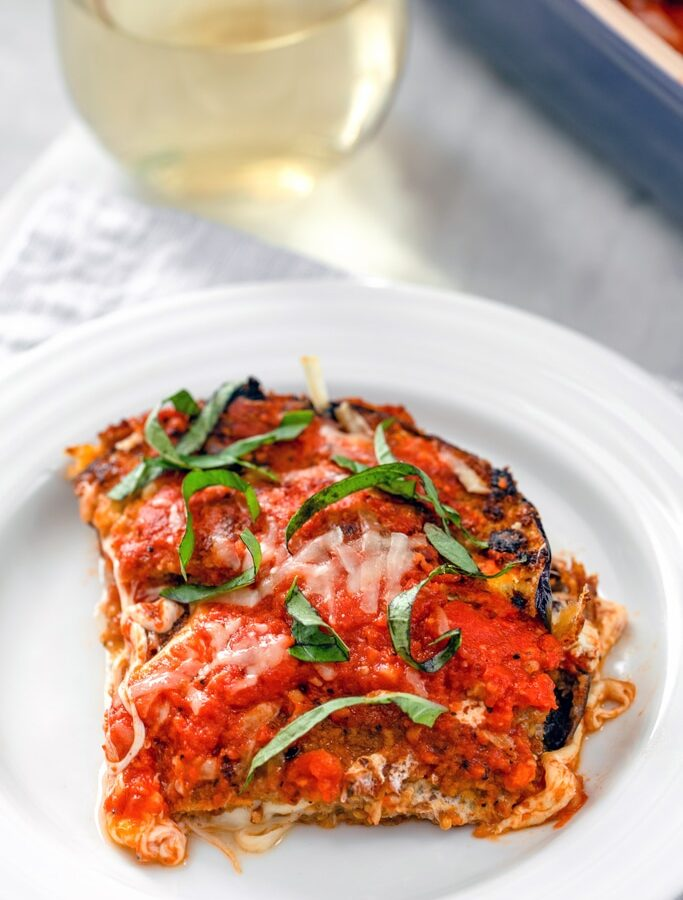 Eggplant Parmesan -- Not only is this eggplant parmesan incredibly easy to make and absolutely delicious, but the eggplant is baked instead of fried making it just a little bit healthier, too! | wearenotmartha.com