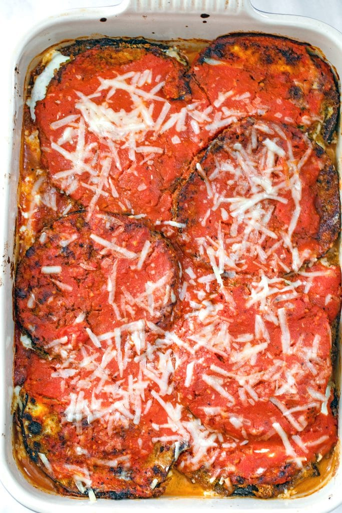 Overhead view of eggplant parmesan in casserole dish right out of the oven
