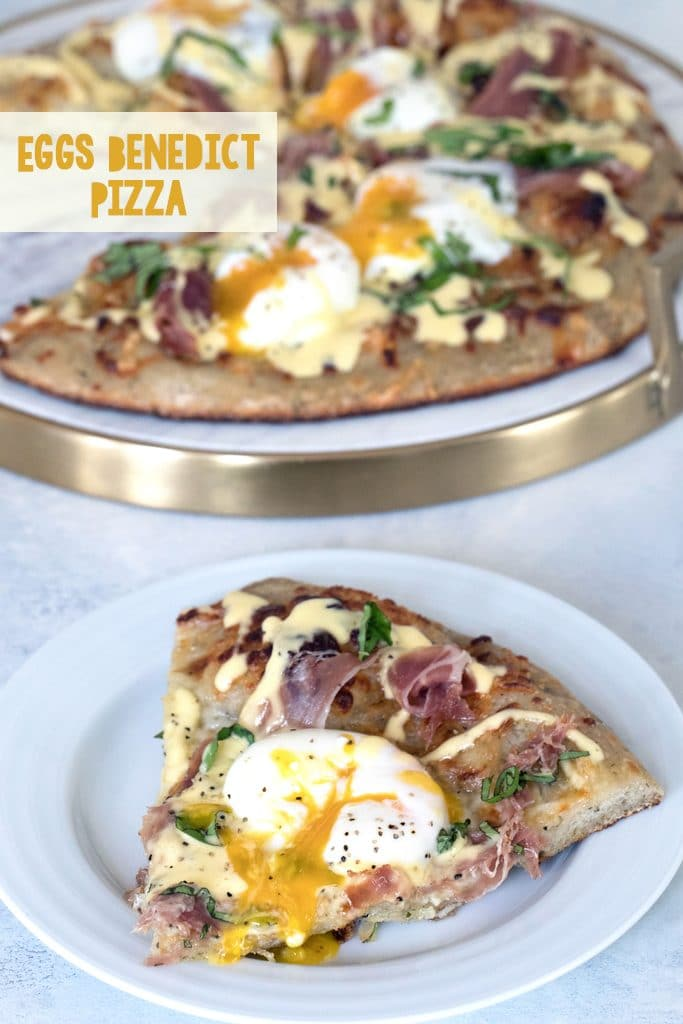 Overhead view of a slice of eggs benedict pizza with runny egg on a white plate with rest of brunch pizza in background and recipe title at top