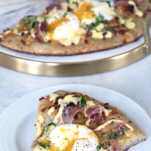 Eggs Benedict Pizza -- What could be better than combining two of the best foods on Earth into an Eggs Benedict Pizza? Packed with prosciutto, hollandaise sauce, and perfectly cooked eggs, you'll fall in love with this brunch pizza | wearenotmartha.com