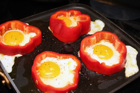 ... one egg in each baked eggs in a bell pepper eggs in a red pepper eggs