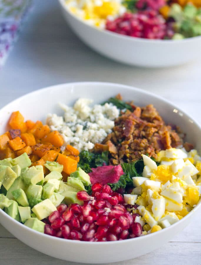 Fall Cobb Salad with Cranberry Dressing -- With kale, butternut squash, hardboiled egg, pomegranate, cranberry dressing, and more, this Fall Cobb Salad is the perfect balance of healthy and indulgent! | wearenotmartha.com