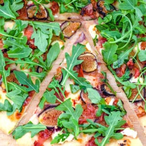 Fig, Prosciutto, and Goat Cheese Flatbread -- This Fig, Prosciutto, and Goat Cheese Flatbread is a little bit sweet, a little bit salty and the kind of flatbread that will make you wish fresh fig season was year round! | wearenotmartha.com