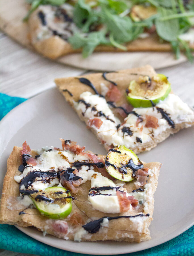 Fig, Prosciutto, and Ricotta Flatbread -- Don't let summer pass by without taking advantage of fresh figs. This Fig, Prosciutto, and Ricotta Flatbread is packed with flavor and is the perfect combination of salty and sweet | wearenotmartha.com