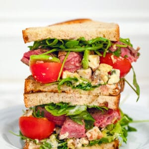 Flank Steak Sandwiches -- Got leftover flank steak? Make these Flank Steak Sandwiches with arugula, tomato, avocado, and gorgonzola. In fact, you might find yourself cooking flank steak just to make these sandwiches | wearenotmartha.com