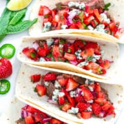 Flank Steak Tacos with Strawberry Mint Salsa -- These Flank Steak Tacos are a flavor explosion thanks to strawberry mint salsa and gorgonzola cheese... They'll help you hold on to summer for as long as possible! | wearenotmartha.com