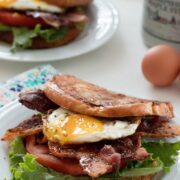 French Toast BLTs -- This breakfast sandwich will give you a reason to get out of bed in the morning! Made with challah or brioche french toast, crispy bacon, lettuce, tomato, and a fried egg, be sure to drizzle plenty of maple syrup over the top before serving   wearenotmartha.com