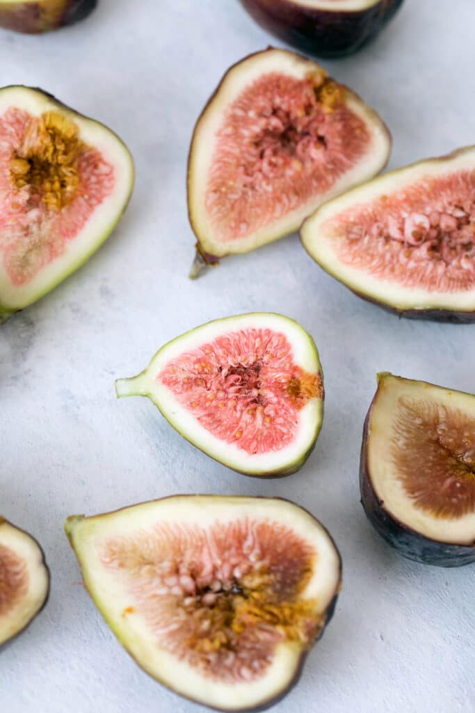Overhead view of several fresh figs sliced in half