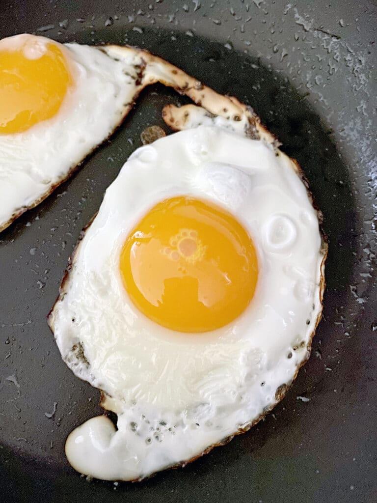 Eggs frying in skillet