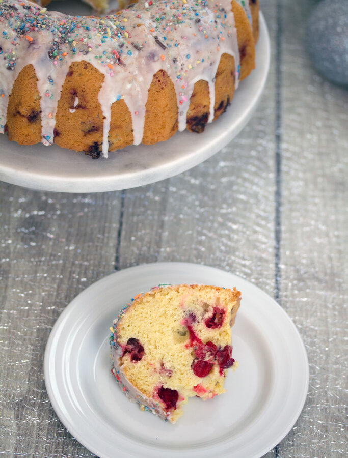 Frosted Vanilla Cookie Cranberry Bundt Cake -- A classic holiday cake with a sweet twist   wearenotmartha.com