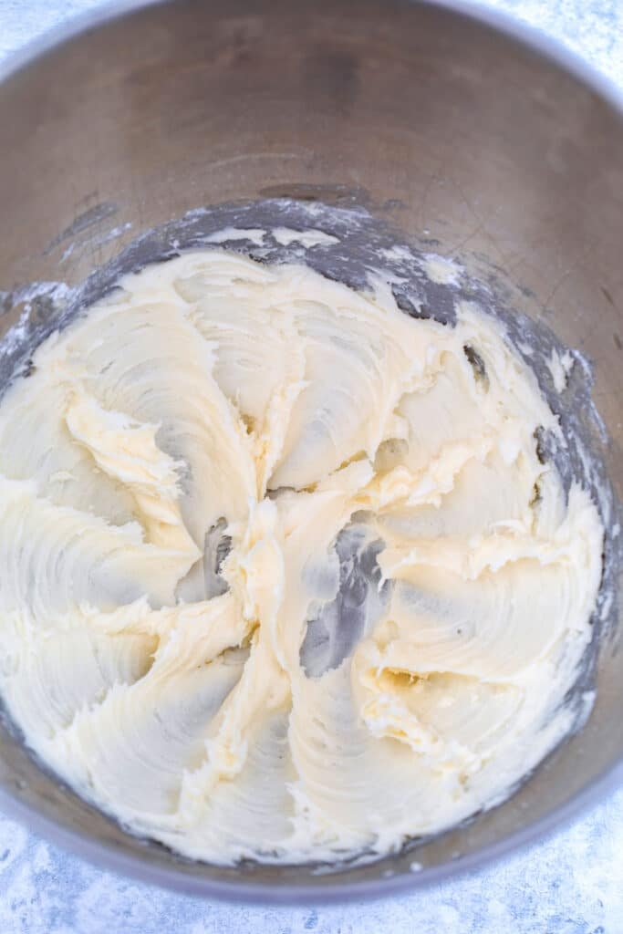 Overhead view of buttercream frosting in mixing bowl