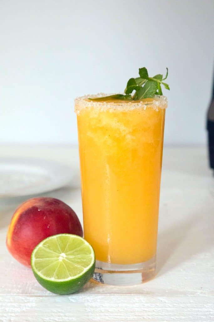 Frozen Peach Margaritas -- These margaritas made with fresh peaches, tequila and honey will become your official summer cocktail | wearenotmartha.com
