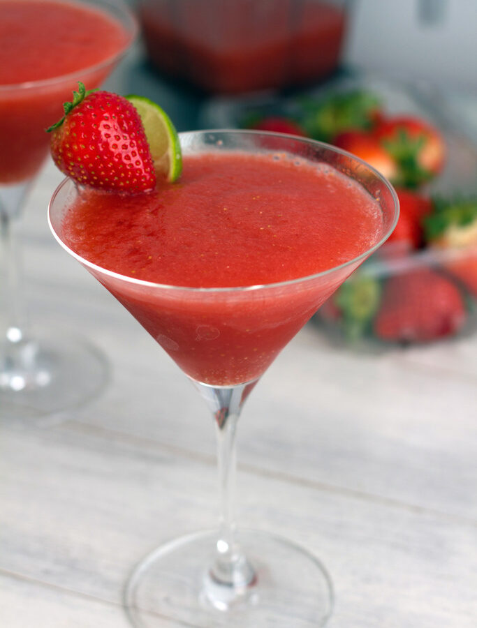 Frozen Strawberry Cosmo -- Remember the cosmo? It's back! But this time the cranberry and lime are combined with frozen strawberries for an icy frozen strawberry cosmopolitan treat | wearenotmartha.com