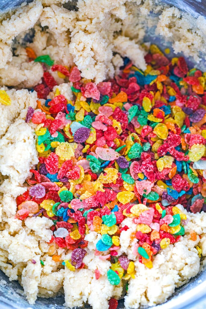 Fruity Pebbles cereal sprinkled over cookie dough