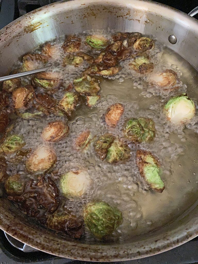 Brussels sprouts frying in canola oil