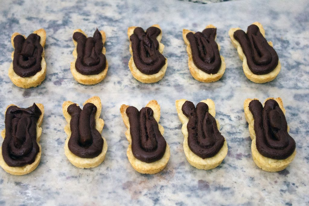 Fudge filling piped onto Peeps cookies