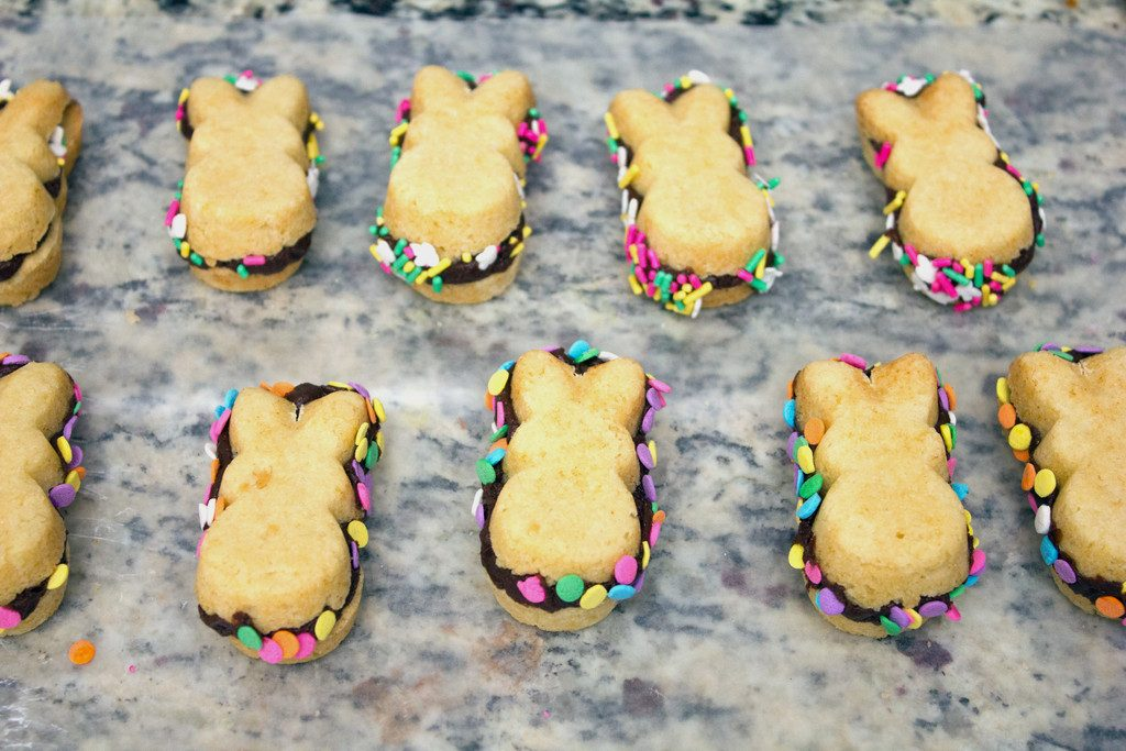 Peeps cookies sandwiched with chocolate fudge and sprinkles