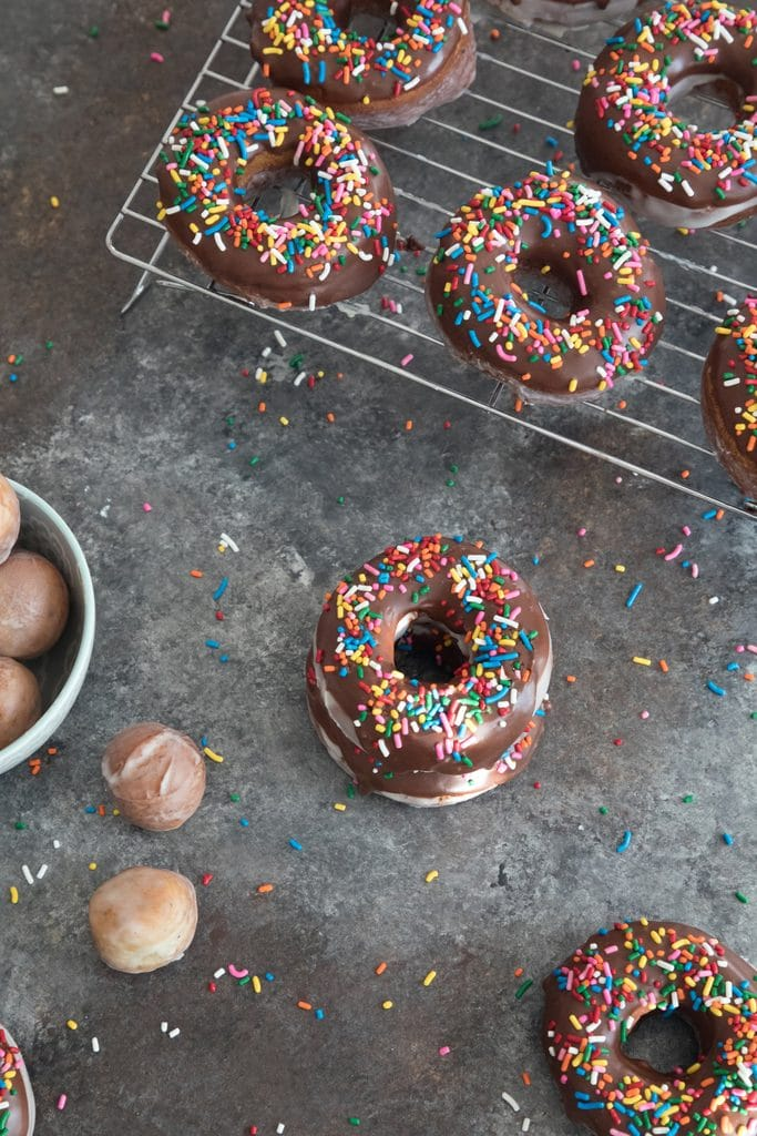 Glazed Coffee Chocolate Frosted Donuts -- If you're going to fry donuts, you may as well go all out and make glazed chocolate frosted donuts. And make them coffee flavored for good measure! | wearenotmartha.com