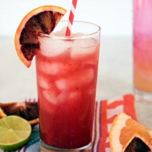 Grapefruit Blood Orange Cocktail -- Winter citrus fruits make this a stunningly colorful and delicious drink. It's both refreshing and warming at the same time | wearenotmartha.com