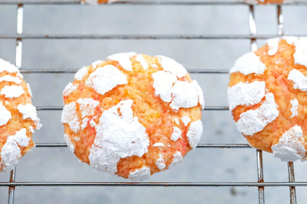 Crinkle cookies with confectioners' sugar right out of the oven