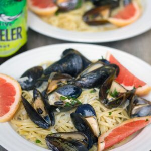 "Grapefruit Shandy Mussels with Grapefruit Linguine -- Grapefruit Shandy Mussels with Grapefruit Linguine is the ""eat on the deck"" summer meal you've been waiting for. Mussels and pasta packed with a citrus punch! 