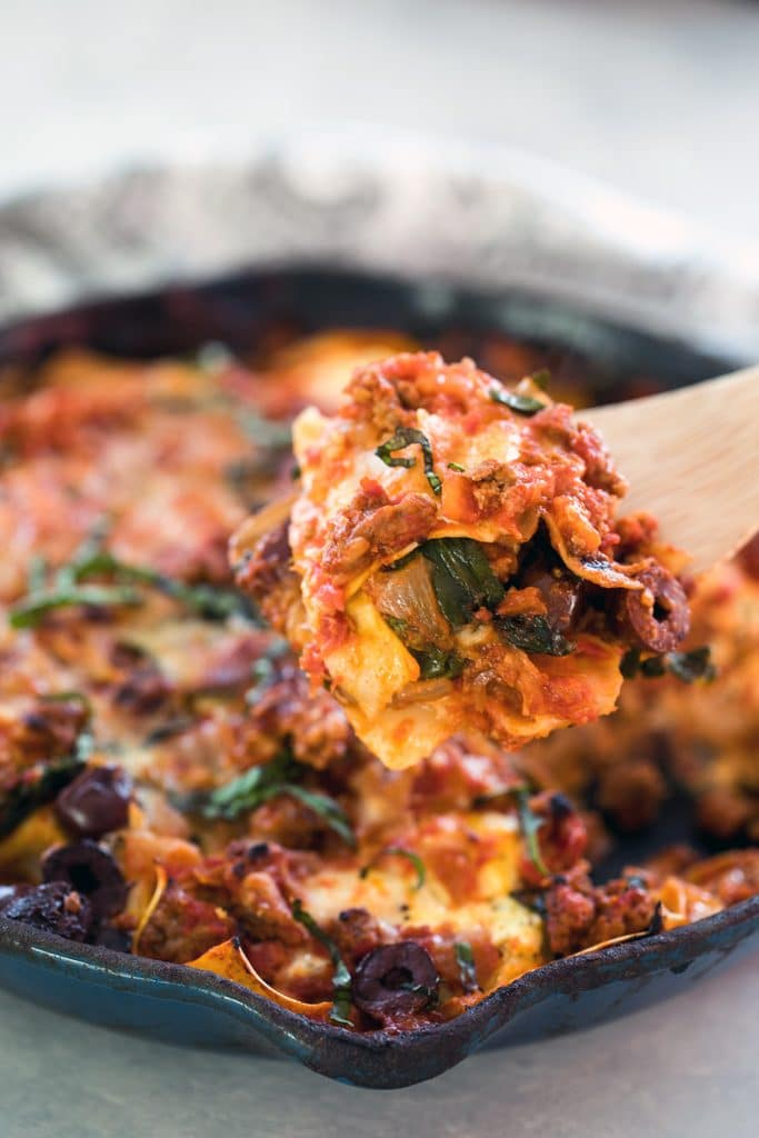 Greek Skillet Lasagna -- This lasagna is packed with Greek flavors, including ground lamb, feta, and kalamata olives, for a fun and easy-to-make (and cleanup!) twist on traditional lasagna | wearenotmartha.com