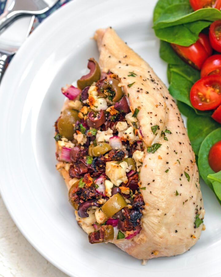 Greek-Stuffed Chicken -- These chicken breasts are absolutely packed with Greek flavors, like olives, feta, sun-dried tomatoes, and red onion. If you think chicken breasts are boring, this Greek-Stuffed Chicken will change your mind! | wearenotmartha.com #chickenbreast #chickenrecipes #greekfood #easydinners