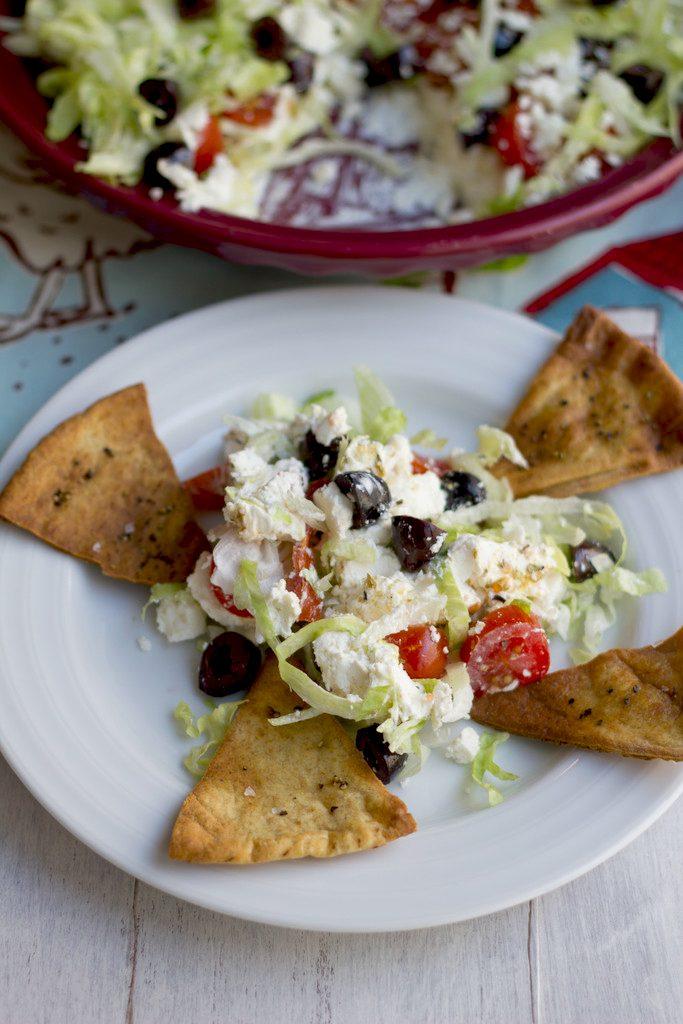 Greek Taco Dip with Black Peppercorn Pita Chips -- The perfect alternative to a party taco dip | wearenotmartha.com