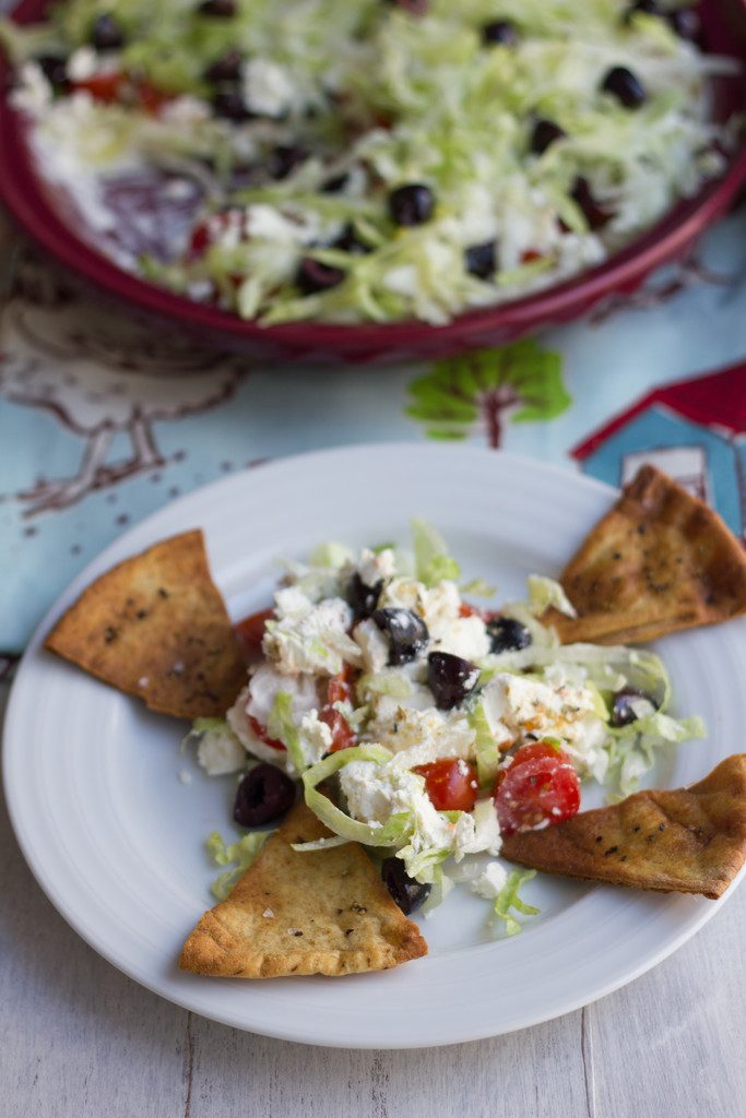 Greek Taco Dip with Black Peppercorn Pita Chips -- The perfect alternative to a party taco dip | wearenotmartha.com