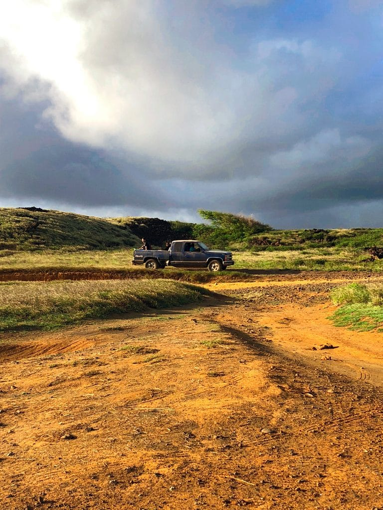 A pickup truck carrying passengers on the hike to Papakolea, the Green Sand Beach in Kona on the Big Island of Hawaii