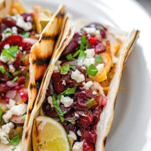Fire up the grill for these Grilled Cod Tacos! Not only is the fish grilled, but nearly everything in the tacos is, including the grilled cherry salsa!