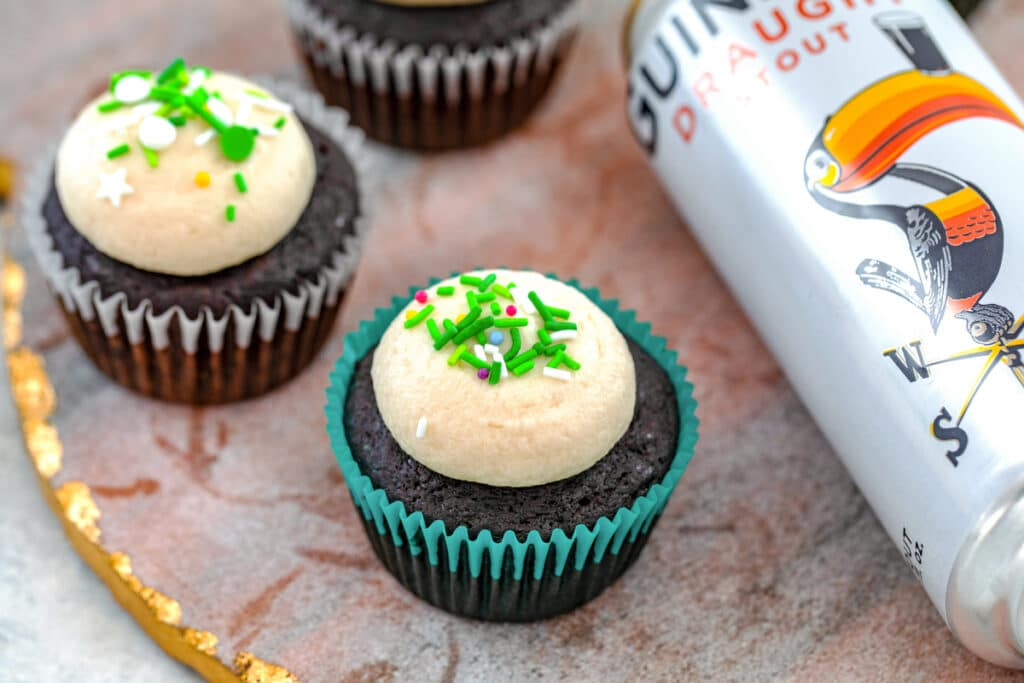 Landscape overhead view of multiple Guinness cupcakes with can of Guinness next to them