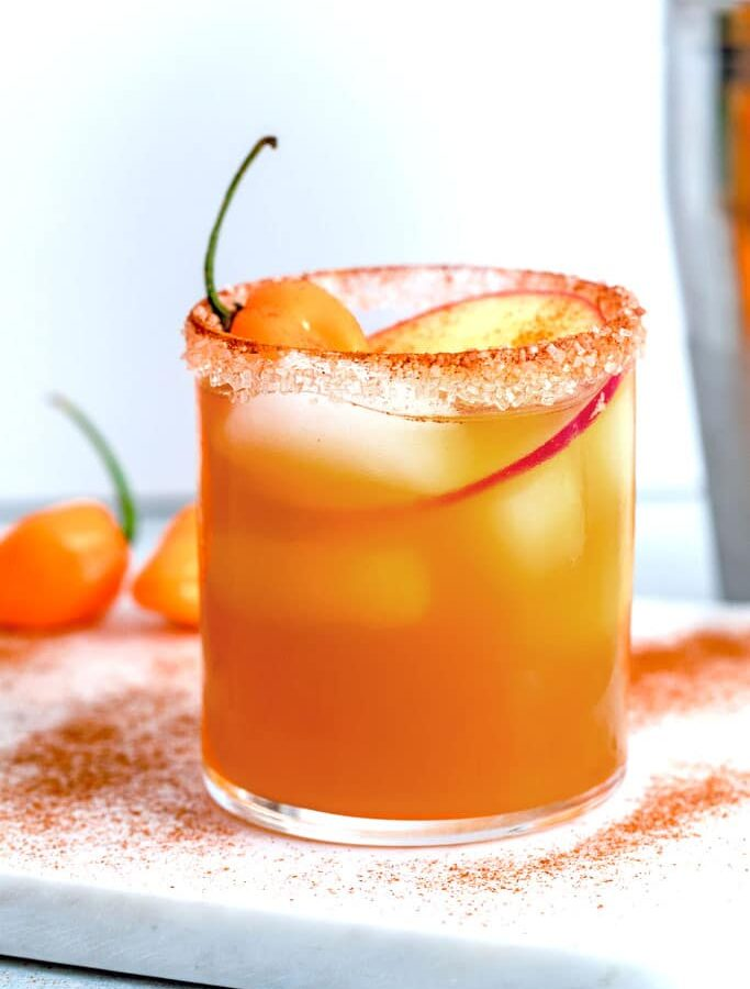 Habanero Ginger Apple Cider Cocktail -- This Habanero Ginger Apple Cider Cocktail is a simple, but delicious fall cocktail consisting of apple cider, rum, and a wonderfully spicy habanero ginger simple syrup. Despite being served chill, it's a cocktail that will warm you up! | wearenotmartha.com