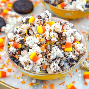 Halloween Party Popcorn -- This Halloween Party Popcorn is a delicious mix of popcorn, white chocolate, Oreo cookies, candy corn, and sprinkles... It's easy to make and always a big crowd pleaser! | wearenotmartha.com