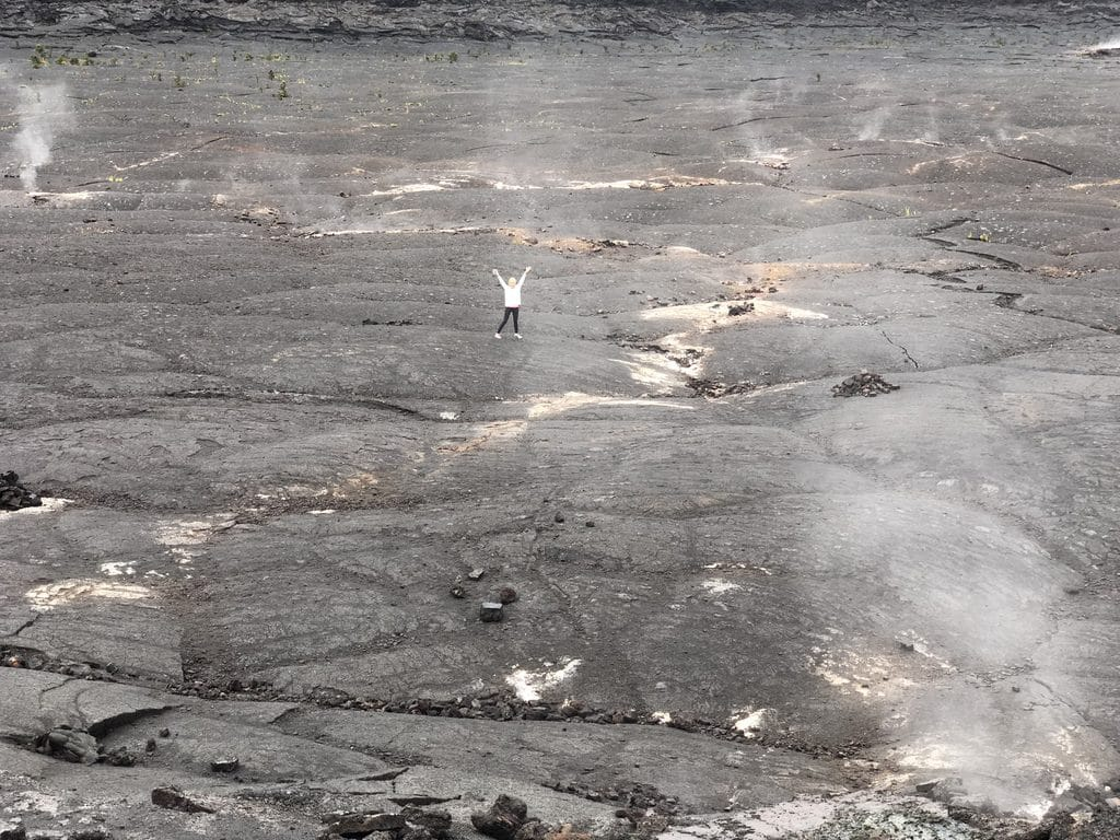 Sues posing on the crater while hiking the Kīlauea Iki Trail at Volcano National Park on the Big Island of Hawaii
