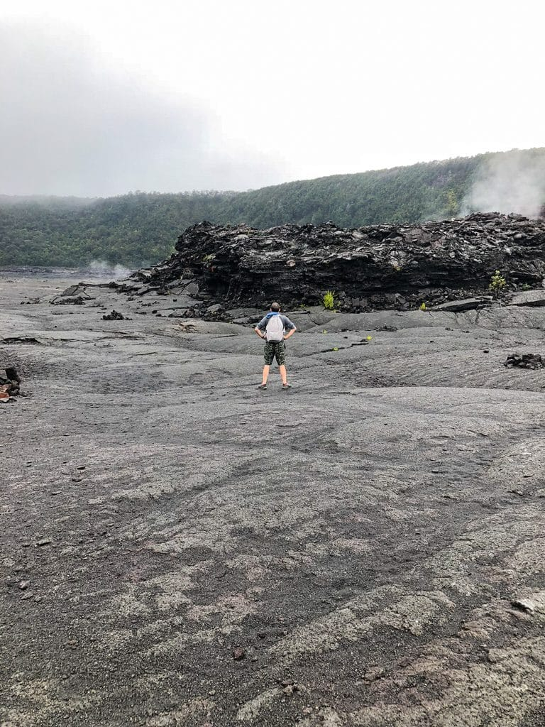 Chris watching the sulphur on the crater while hiking the Kīlauea Iki Trail at Volcano National Park on the Big Island of Hawaii