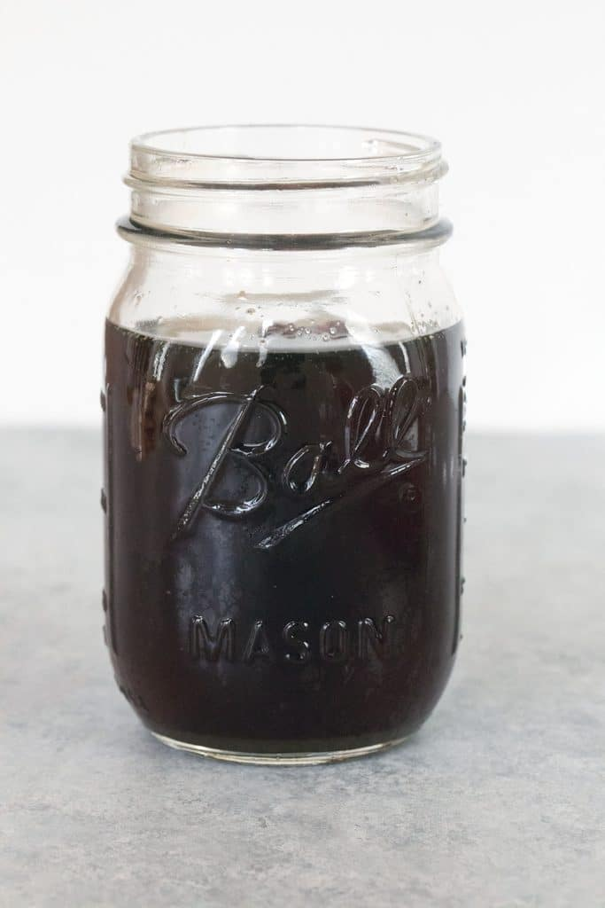 Head-on view of a jar of holiday spiced simple syrup