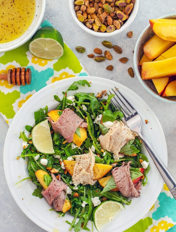 Honey Lime Peach Salad with Roast Beef and Turkey -- For those summer nights when it's too hot to cook, but you're not willing to sacrifice taste, try this summer peach salad. You can prep it in minutes and the result is a light and refreshing summer salad packed with protein.... No oven necessary | wearenotmartha.com