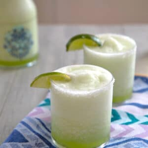 Honeydew Ginger Frozen Margarita -- This bright green frozen honeydew margarita combines fresh honeydew melon, ginger simple syrup, and tequila for a frozen drink that's perfect for any time of the year | wearenotmartha.com