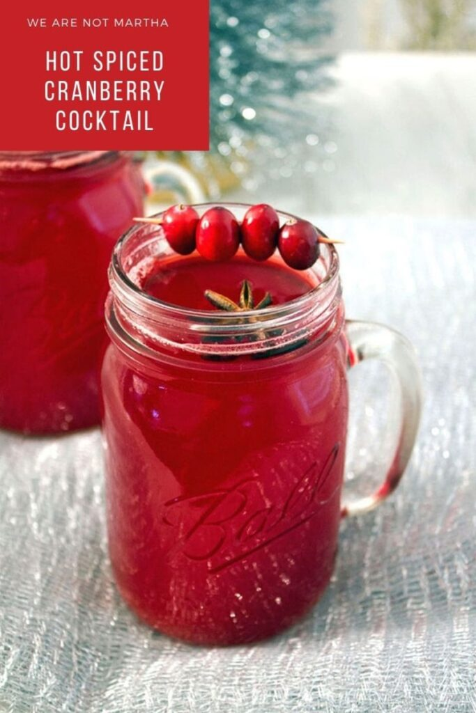 This seasonal cocktail will warm you right up! Made with homemade cranberry juice, lots of spices, and a splash of vodka, this Hot Spiced Cranberry Cocktail is the perfect winter drink | wearenotmartha.com #cranberryjuicce #hotdrinks #christmascocktails #cranberries