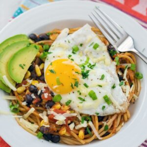 Huevos Rancheros Spaghetti -- Spaghetti for breakfast? Totally acceptable if it's this Huevos Rancheros Spaghetti dish! Extremely easy to make for either brunch or dinner, there's a good chance you have all the ingredients in your pantry right now | wearenotmartha.com