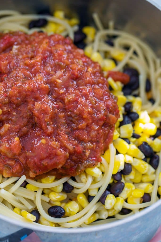 Pot filled with spaghetti, black beans, corn, and salsa