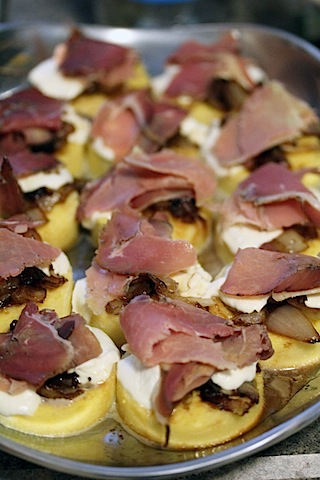 Polenta Rounds with Caramelized Onion, Mozzarella, and Prosciutto